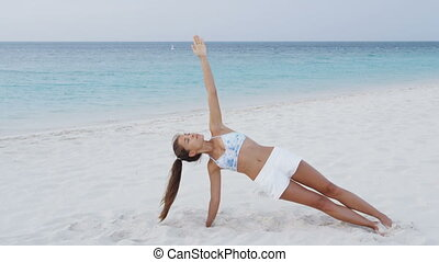 Fitness woman strength training core side plank living ...