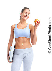 Fitness woman with apple - Fitness and diet. Smiling young...