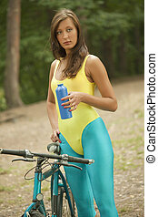 fitness woman with bottle and bike