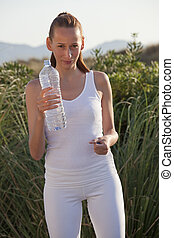 fitness woman with bottle water