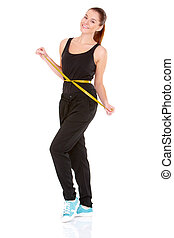 Fitness woman with measure tape on