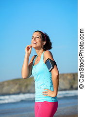 Fitness woman with sport band listening music