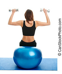 Fitness women doing weightlifting on fitness ball - Fitness...