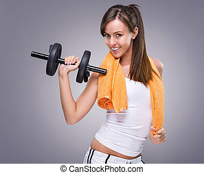 Fitness women hold  dumbbell