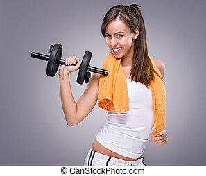 Fitness women hold dumbbell
