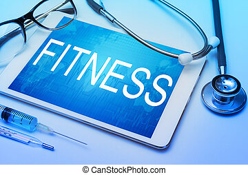 Fitness word on tablet screen with medical equipment on background
