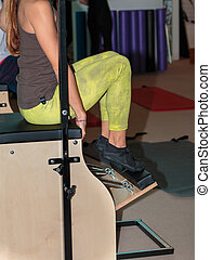 Fitness Workout in Gym: Girl doing Exercise on Wooden Chair