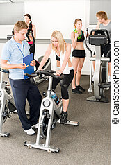 Fitness young girls at gym with instructor