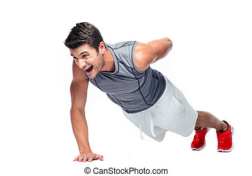 Fitness young man doing push ups