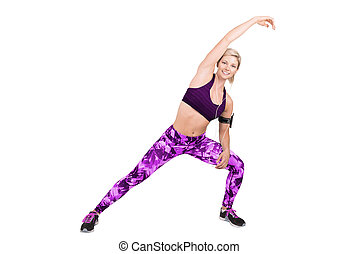 Fitness young woman doing stretching, isolated on white background.