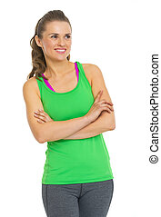 Fitness young woman looking on copy space
