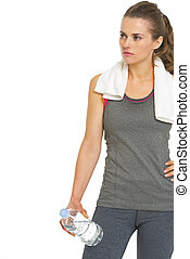 Fitness young woman with towel and bottle of water looking on copy space