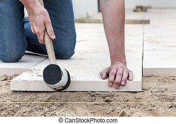 Fitting the concrete slab - Man hitting the concrete slab...