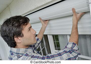 Fitting window shutters