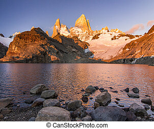 Fitz Roy mountain and lake at red sunrise