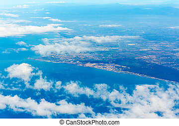 Fiumicino bay with clouds from the aircraft - Aerrial view ...