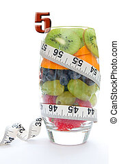 Five a day - Five fruits packed into a glass including kiwi,...