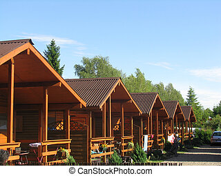 Five A Frame Chalets in a line