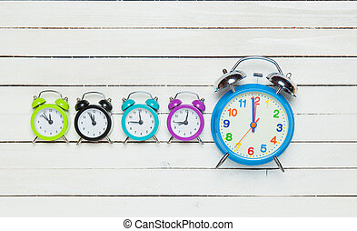 Five alarm clock on white background.