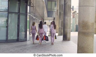 Five attractive business women walking in the city