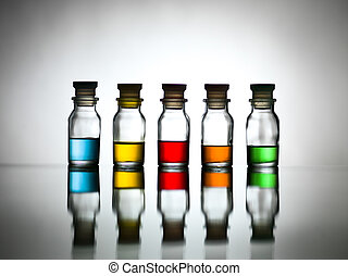 Five bottles with different coloured substance