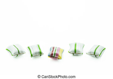 Five candies isolated on white