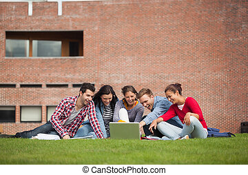 Five casual students sitting on th - Five casual students...