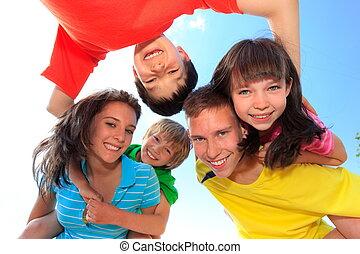 Five children looking down - Five happy laughing children,...