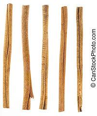 five cinnamon sticks isolated on white. High angled cinnamon...