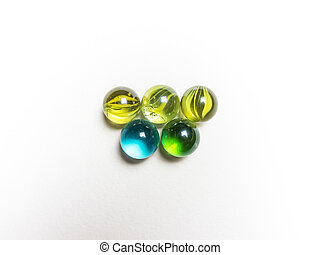 Five colored glass balls with caustics on a white background