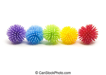 Five colorful Koosh stress balls in a line. Colors include purple, blue, green, yellow, and red.