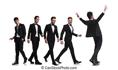 five elegant men walking in different directions and one celebrating