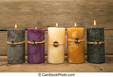 Five Feng Shui candles against rustic wood
