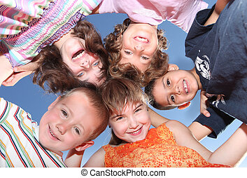 Five Friends Outdoors Looking Down Smiling - Group of Five...