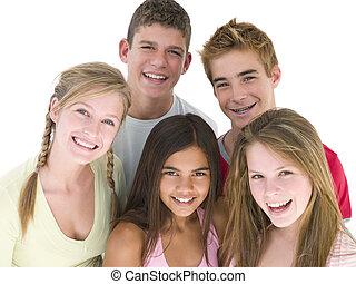 Five friends together smiling