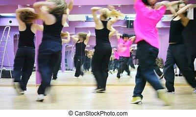 Five girls dance together in violet dancing room