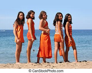 Five girls on the beach