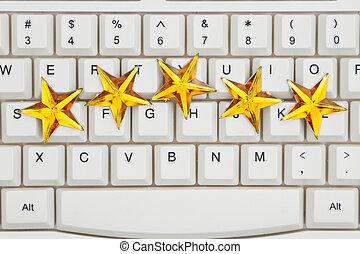 Five gold stars on a keyboard