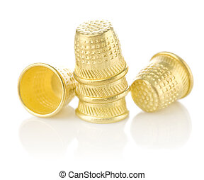 five golden timbles isolated on white background