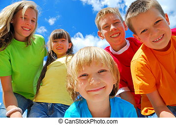 Five Happy Kids - A group of five happy kids with a blue sky...