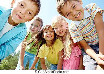 Five happy kids - Portrait of happy kids outdoor looking at...