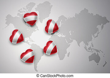 five hearts with national flag of austria on a world map background.