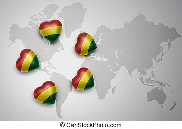 five hearts with national flag of bolivia on a world map background