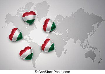 five hearts with national flag of hungary on a world map background.