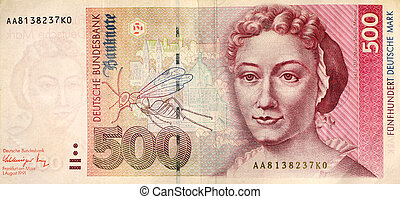 Macro of a demonetised 500DM note from the last series of German marks prior to the introduction of the euro 2002. The Bundesbank has subsequently found itself forced to prop up the new currency because of the problems of weaker eurozone economies.