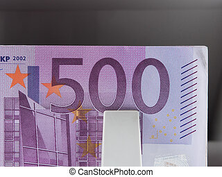 five hundred euro banknotes in a counting machine