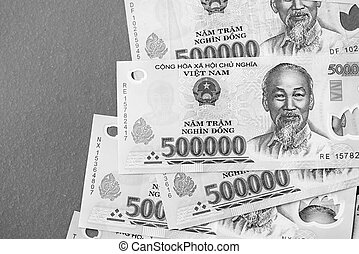 Five hundred thousand dong banknotes close-up. Money background black and white