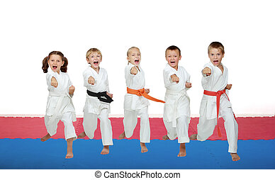 Five karate athletes beat a punch arm
