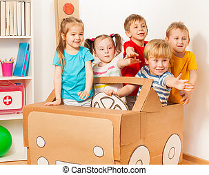 Five little drivers playing with cardboard car
