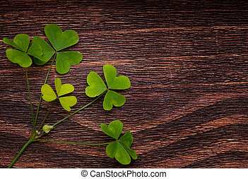 Five lucky shamrocks on a old wood vintage background